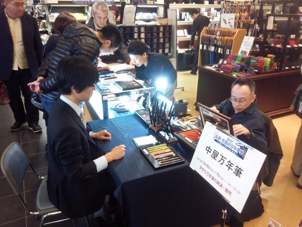 Mr. Yoshida works on the youngest man at the show's new purchase.