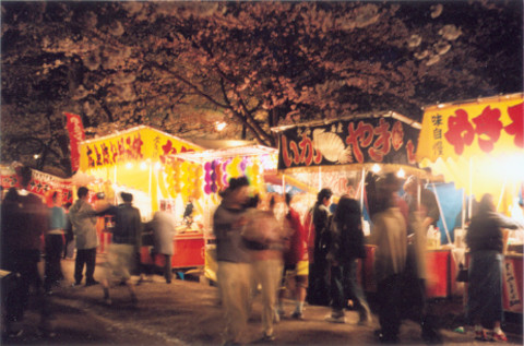I rather be here. The food stands at Takada Park in Joetsu. It's famous for its night Hanami.