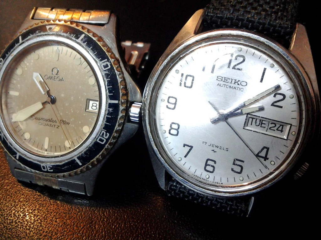 The Omega Seamaster on the left and the Seiko on the right. You can see  the big crack in it.