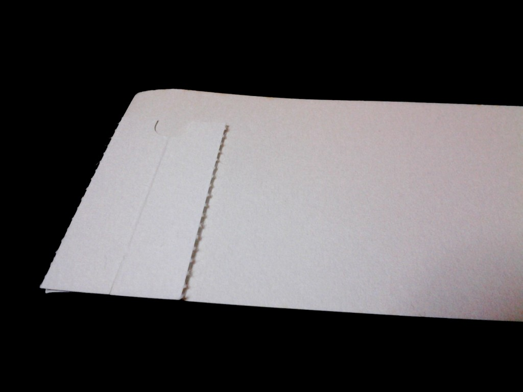 A piece of SUITO cleaning paper on a strip of blotter paper.
