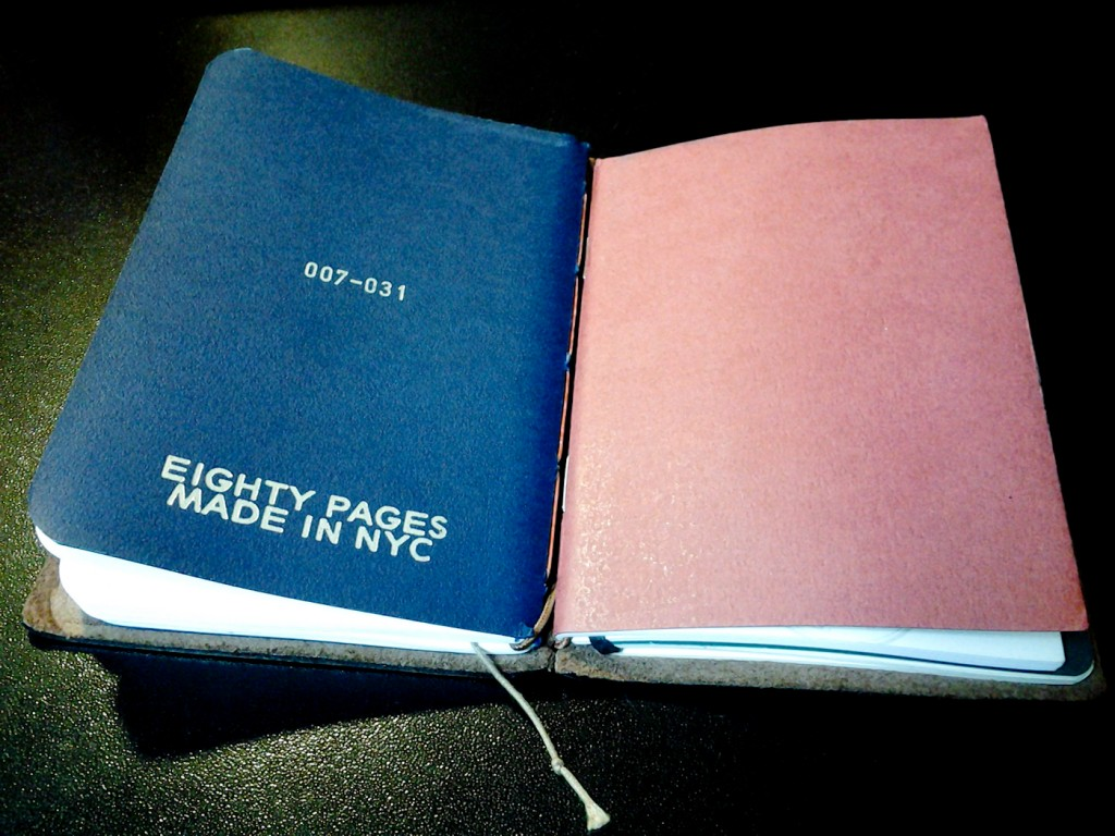The Eighty Pages notebook next to a Midori notebook in my Traveler's cover.